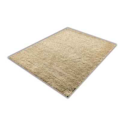 Beżowy dywan shaggy