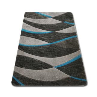 Modny dywan wycinany w fale niebieskie