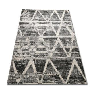 szare trójkąty na dywanie