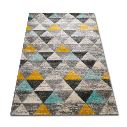 dywan w trójkąciki turkusowo żółte