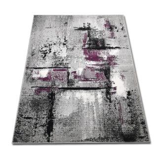 przecierany dywan fioletowy