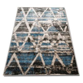 Modny dywan przecierany turkusowy
