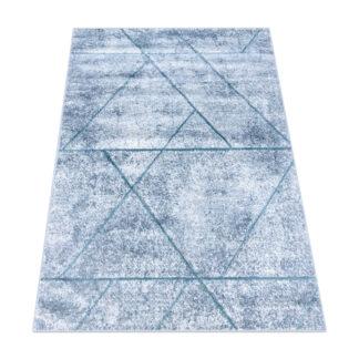 Niebieskie linie geometryczne na dywanie