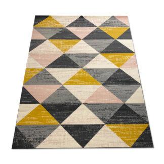 dywan w trójkąty żółto różowe