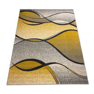 Żółty dywan z szarym fala